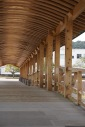 The curve of the roof is meant to mimic the curve of the boats which were traditionally made from Obi Cedar.