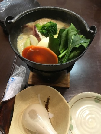 A mini nabe with a little jelly candle thing underneath the cook everything.